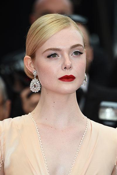 Elle Fanning wearing Chopard jewellery