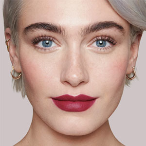 a model sports Lisa Eldridge's Velvet Lipstick in Velvet Myth